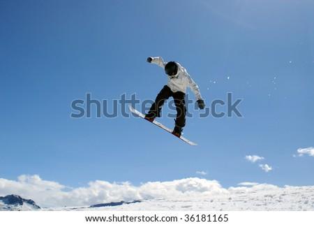 Snowboarder jump through air - stock photo