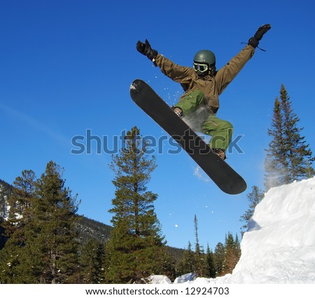 Snowboarder jumping high - stock photo