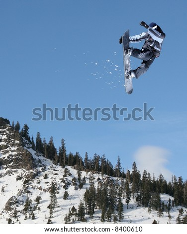 Snowboarder jumping high at Lake Tahoe resort