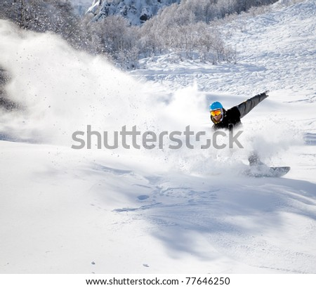 Snowboarder racing down the highway at a speed
