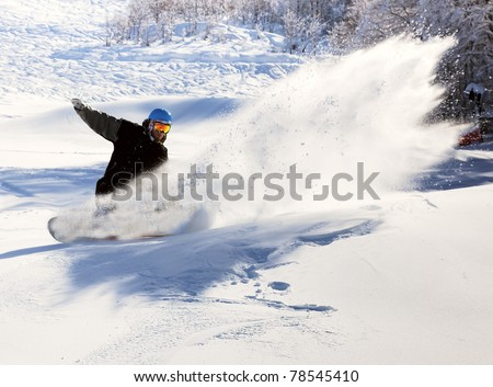 Snowboarder racing down the highway at a speed - stock photo