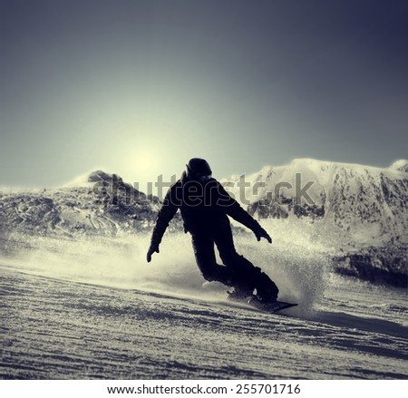 Snowboarder silhouette  - stock photo
