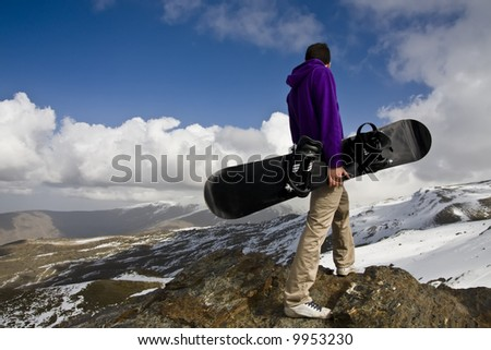 Snowboarder standed up at the top of the hill. - stock photo