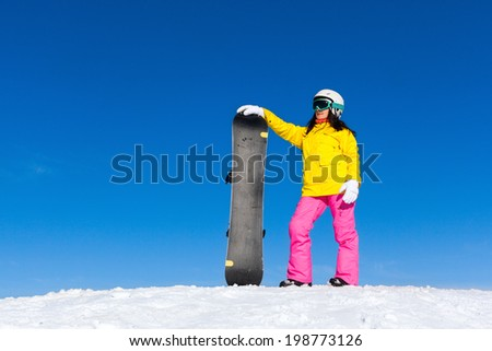 snowboarder standing hold snowboard, snow mountain slope copy space blue sky