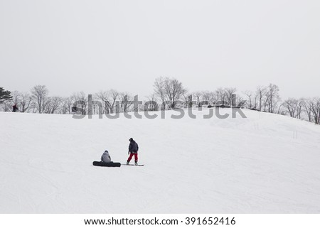 Snowboarders in high mountain
