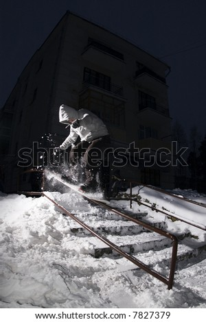 Snowboarding at night - stock photo