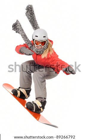 snowboarding woman with snowboard having fun - stock photo