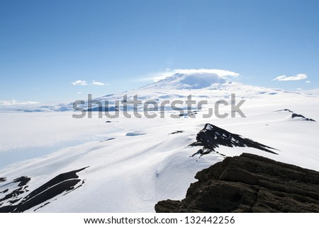 Snowcapped mountain in Antarctica - stock photo