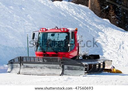 Snowcat - special trucked machine to prepare ski slopes - stock photo