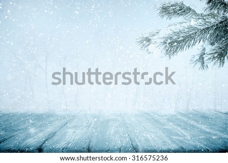 Snowdrift near frozen wooden path in winter on sunny day - stock photo