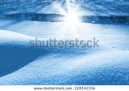 Snowdrifts at the freezing small river - stock photo