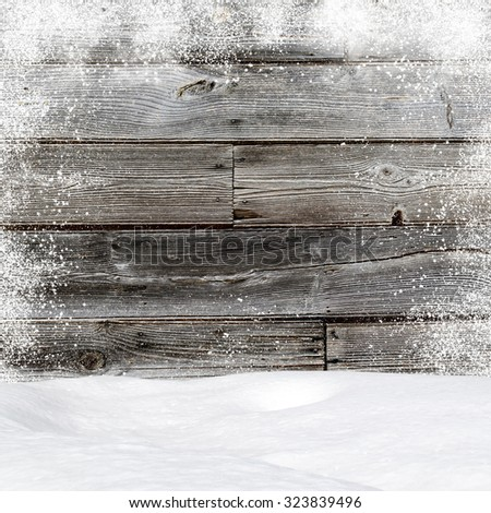 Snowdrifts. In the background old wooden wall with blank space