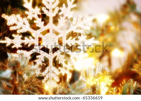 snowflake christmas tree ornament with lights - stock photo