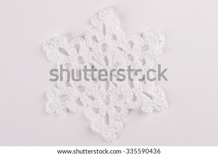 snowflake, Crochet of white thread on white background