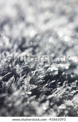 Snowflake crystals captured on a sunny evening. Ideal for winter background or wallpaper - stock photo