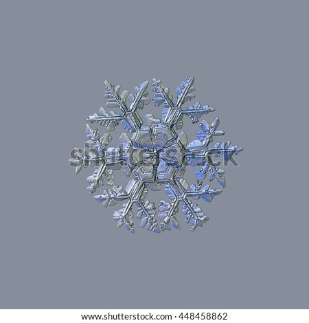 Snowflake isolated on light grey background: macro photo of real snow crystal, captured on glass. This is large stellar dendrite snowflake, slightly molten, with massive arms and big central hexagon. - stock photo
