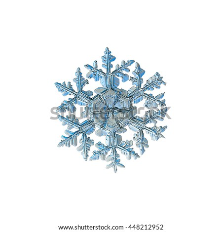 Snowflake isolated on white background: macro photo of real snow crystal, captured on glass with LED back light. This is big snowflake of stellar dendrite type with ornate arms and massive center. - stock photo