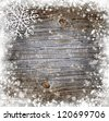 Snowflake on a snowbound old wooden background - stock photo