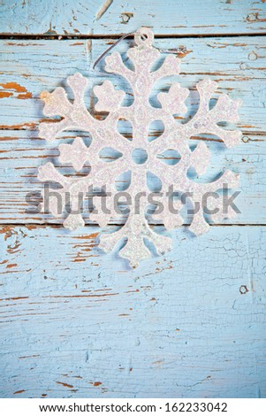 snowflake on a wooden background - stock photo