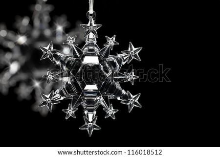 Snowflake ornaments on black background - stock photo