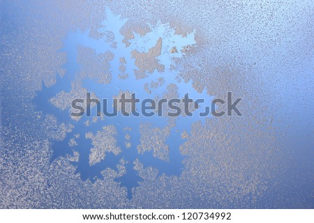 Snowflake pattern on window - stock photo