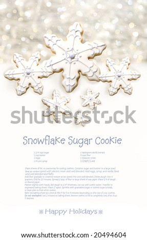 Snowflake sugar cookies with recipe on holiday background