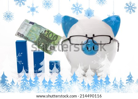 Snowflakes and fir trees against piggy bank wearing glasses with blue graph model and hundred euro note - stock photo