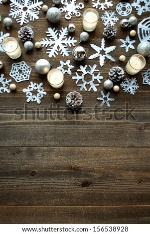 snowflakescandles and christmas ornamentspaper cutout of snowflakes