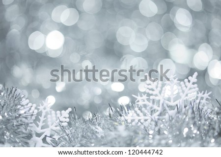Snowflakes in tinsel - stock photo