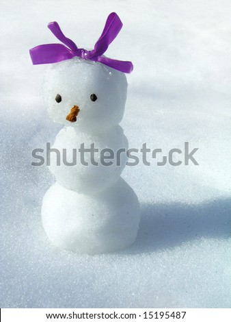 snowgirl with a bow on a background of a snow - stock photo