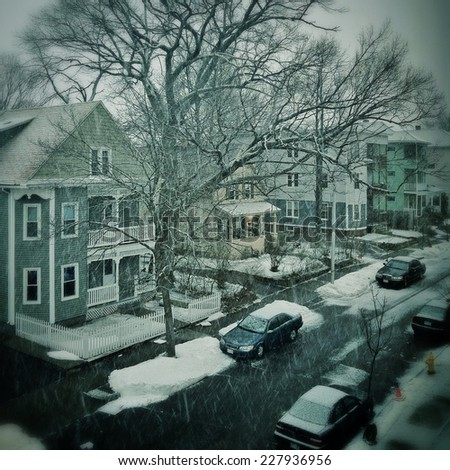 Snowing in a city neighborhood - stock photo