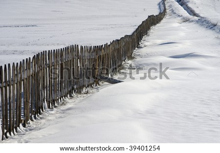 snowlandscape with a fence