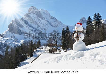 Snowman against Alpine panorama. Switzerland  - stock photo