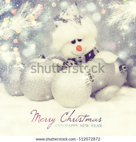 Snowman and Christmas decorations on a silver background.