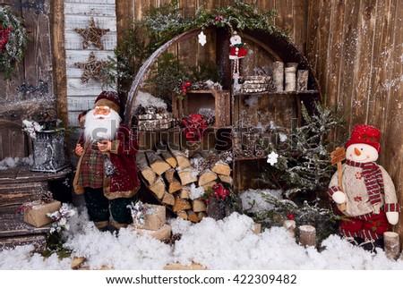 Snowman and Santa in winter decor - stock photo