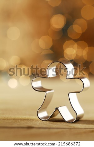 Snowman cookie cutter with a sparkling sepia bokeh of sparkling party lights celebrating Christmas with copyspace for your greeting - stock photo