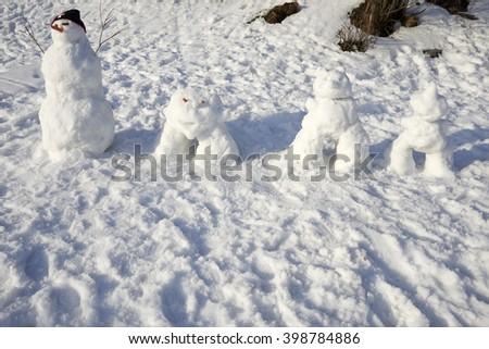 Snowman creature standing in winter landscape - stock photo