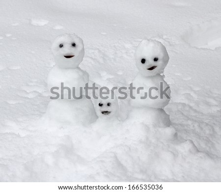 Snowman family, father, mother, child - stock photo