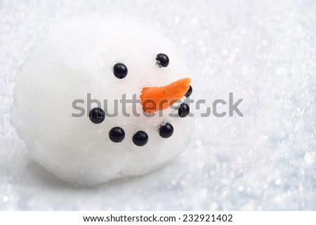 Snowman had on snow background. - stock photo