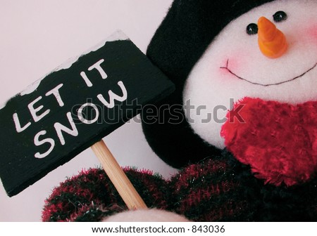 snowman holding sign saying let it snow - stock photo