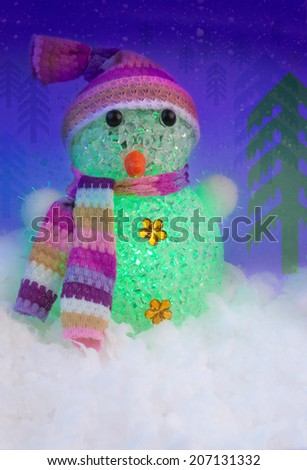 Snowman Illuminated with Green Light in the Winter Forest - stock photo