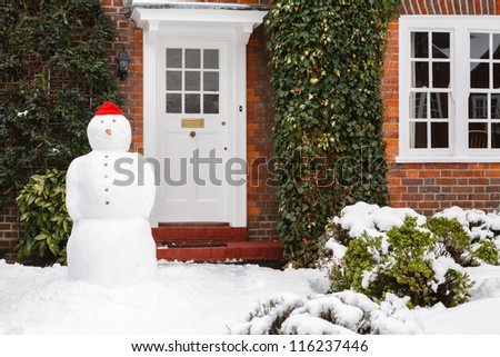Snowman in garden - stock photo