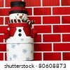 Snowman made of Gift Boxes isolated on red brick wall background - stock photo