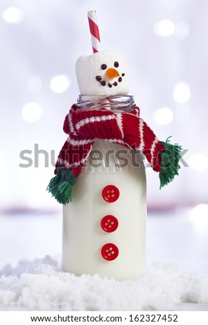 Snowman milk bottle - stock photo