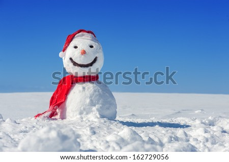 snowman on blue sky background - stock photo