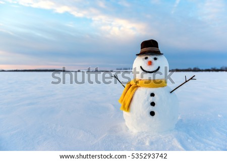 snowman on orange sunset background