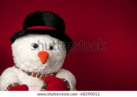 Snowman on red background with message space - stock photo