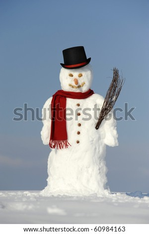 snowman with black hat and shawl - stock photo