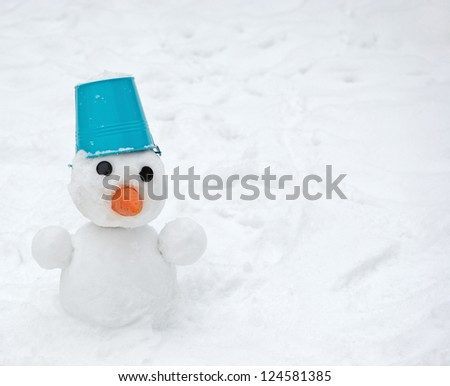 Snowman with blue bucket on the head