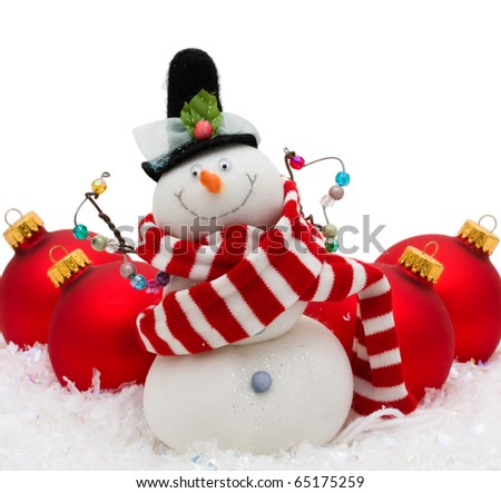 Snowman with red glass Christmas balls on snowflake background, Christmas Time - stock photo